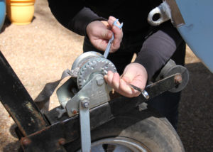 Replace A Winch Strap - unscrew